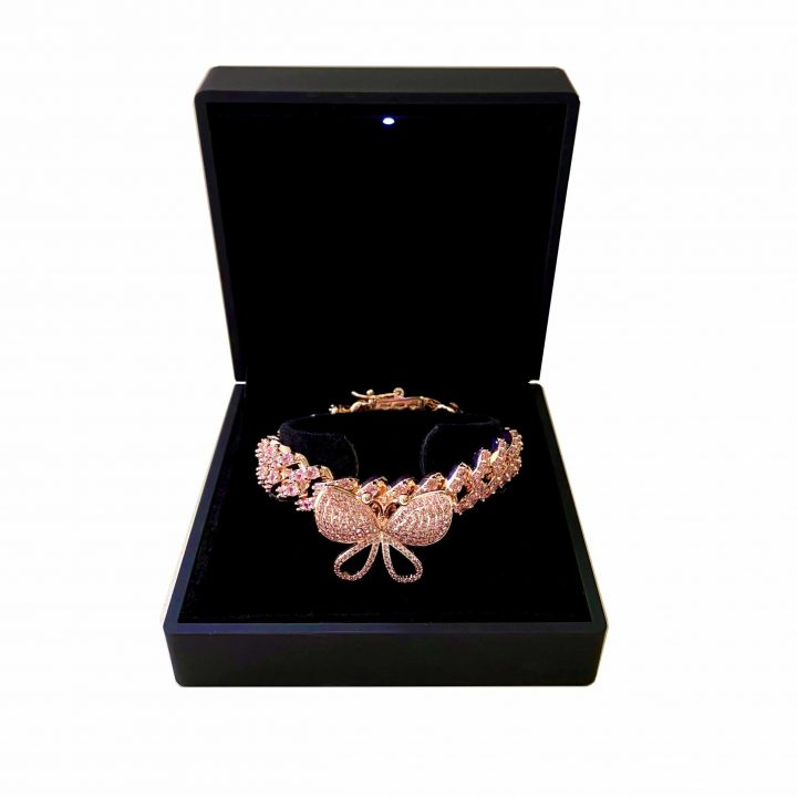 Rose Gold coloured Cuban Link Bracelet featuring a spinning butterfly charm to the front and clear cut crystals throughout the band