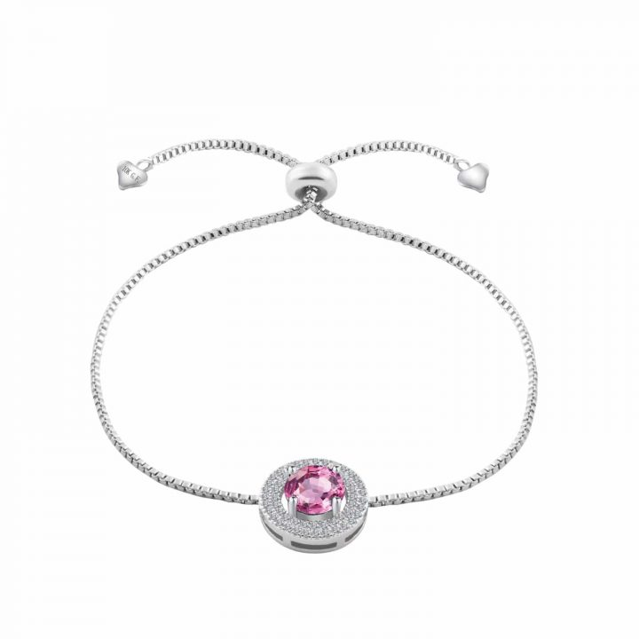 rhodium plated adjustable bracelet featuring a large pink simulated sapphire and smaller clear cut gemstones
