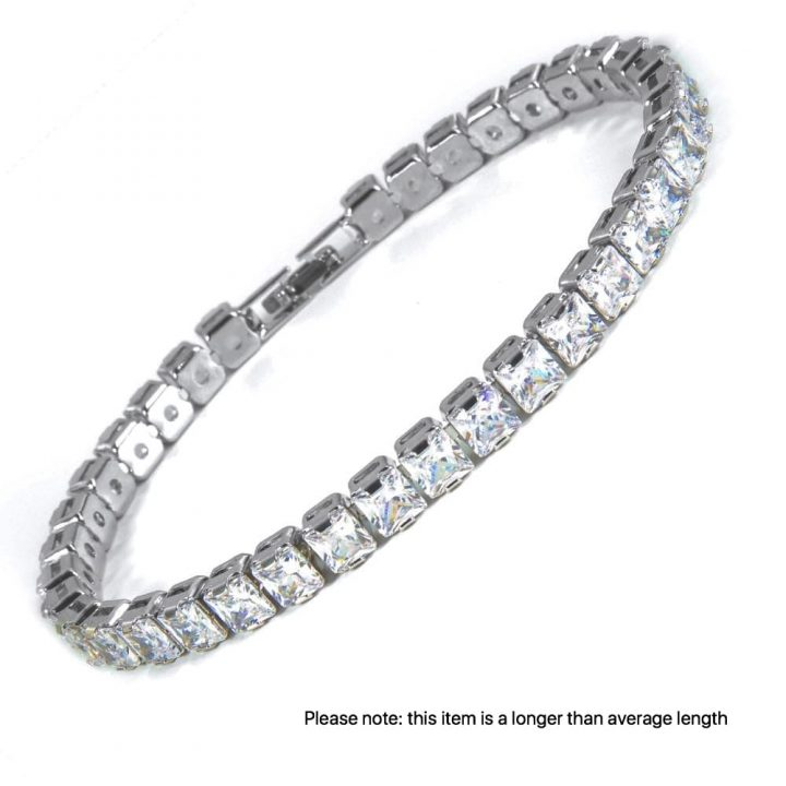 Silver toned rhodium plated bracelet featuring square cut, clear crystals finished with a secure and subtle clasp.