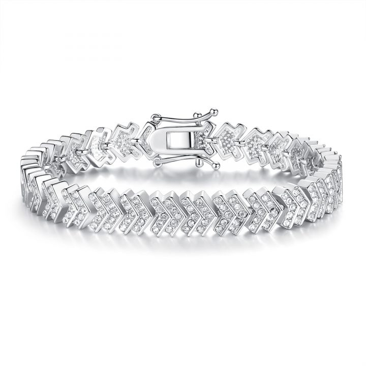 Silver toned, white gold plated bracelet featuring clear cut crystals set in chevron design links with an elegant clasp integrated into the design