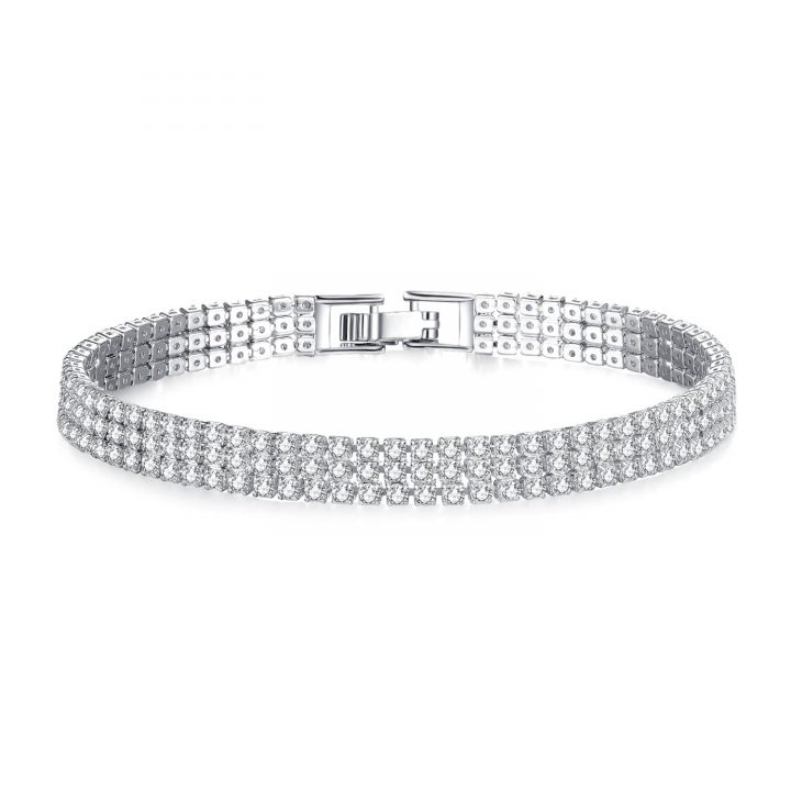 Rhodium Plated strap bracelet featuring over 220 elegant clear cut simulated sapphires, finished with a secure flat clasp