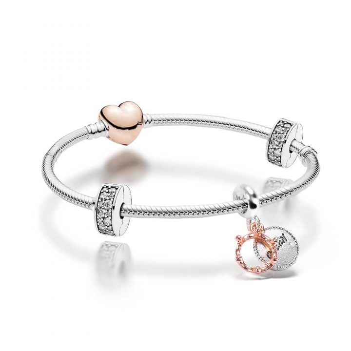 """silver plated bracelet band with clear crystal gemstone stoppers, a """"Queen"""" engraved silver charm and rose gold heart shaped clasp"""