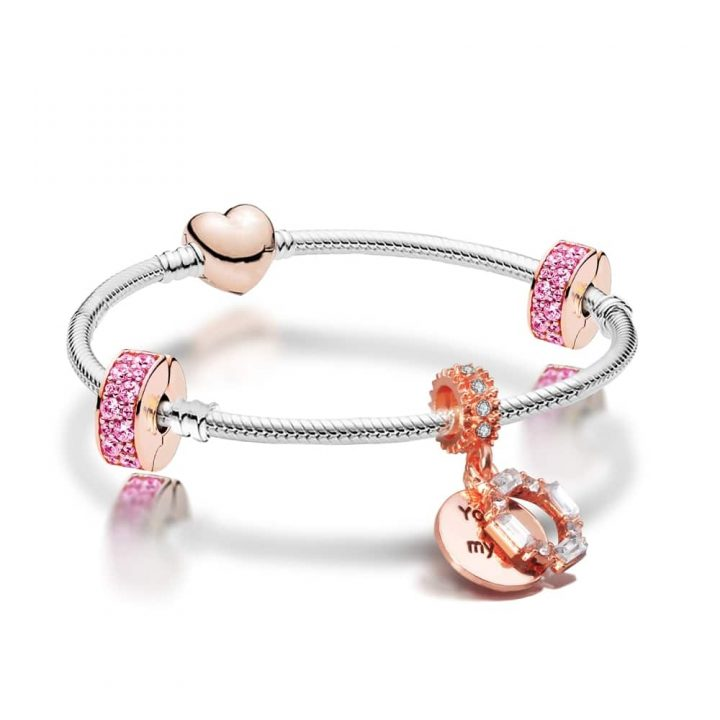 """Silver plated bracelet with two pink crystal stoppers and a rose gold plated charm engraved with the words """"you melt my heart"""""""