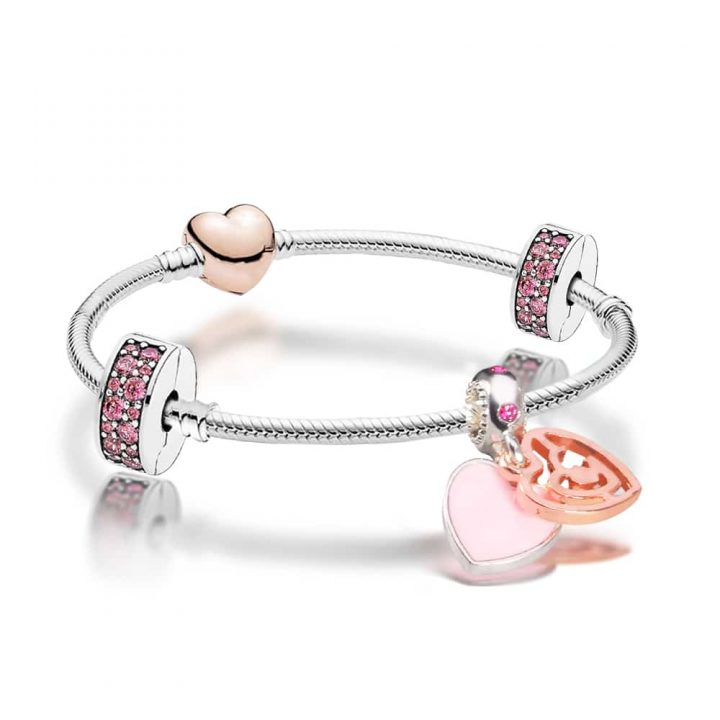 Silver and Rose Gold bracelet decorated with blush pink, rose gold and pink crystal charms