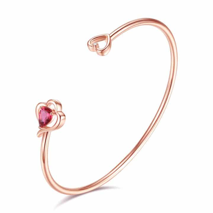 Rose gold bangle featuring pink Swarovski® crystal and clear natural diamond