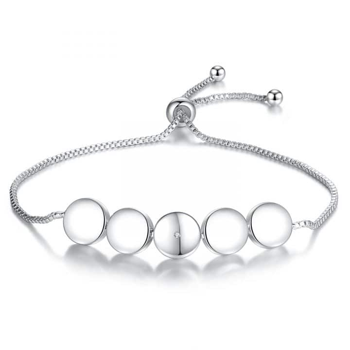 white gold diamond bracelet with 5 white gold discs featuring a single natural diamond in the centre