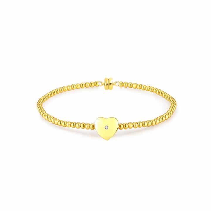 yellow gold plated bracelet featuring a natural diamond within a single heart-shaped accent charm.